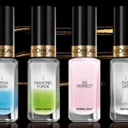 """linia specjalistycznych produktów do pielęgnacji paznokci - """"La Manicure"""" L'Oreal Paris Miracle Repair – odżywczy eliksir 7 w 1 dla paznokci poważnie zniszczonych, słabych, łamliwych Diamond Force – serum 2 w 1 dla słabych i miękkich paznokci. wzmacnia i utwardza miękkie, słabe paznokcie. Zawarty w serum wapń chroni przed rozdwajaniem. Do użytku codziennego jako odżywka lub do stosowania pod kolorowy lakier Omega Grow – serum 2 w 1 by mieć długie i mocne paznokcie. Przezroczysta, wzmacniająca odżywka, która może służyć jako podkład (baza) pod lakier. Kwasy Omega nawilżają i odżywiają paznokcie. Upiększające BB do paznokci 5 w 1 dla niejednolitych paznokci. Upiększa i odżywia. Ta odżywka nie tylko wzmacnia, ale też nadaje paznokciem pastelowy połysk. Ciekawa propozycja dla Pań ceniących naturalny, stonowany manicure. Fast Dry - preparat nawierzchniowy przyspieszający wysychanie lakieru. wysuszacz do lakieru to ochrona koloru, piękny blask i przede wszystkim oszczędność czasu. Wysuszacz znacznie przyspiesza czas schnięcia lakieru Ochronny preparat 2 w 1 – może być stosowany jako baza lub lakier nawierzchniowy. ochronny preparat o podwójnym działaniu. Po co tracić pieniądze na zakup bazy pod lakier i nabłyszczającego utwardzacza, skoro można mieć to wszystko w jednym produkcie."""